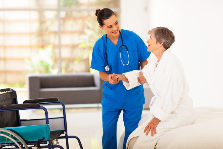 caregiver helping senior woman